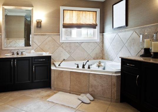 Classic bathroom with brown tiles and corner tub   Townsville Bathroom Renovations
