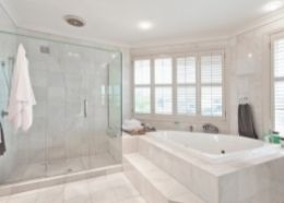 Modern bathroom with glass shower enclosure   Townsville Bathroom Renovations